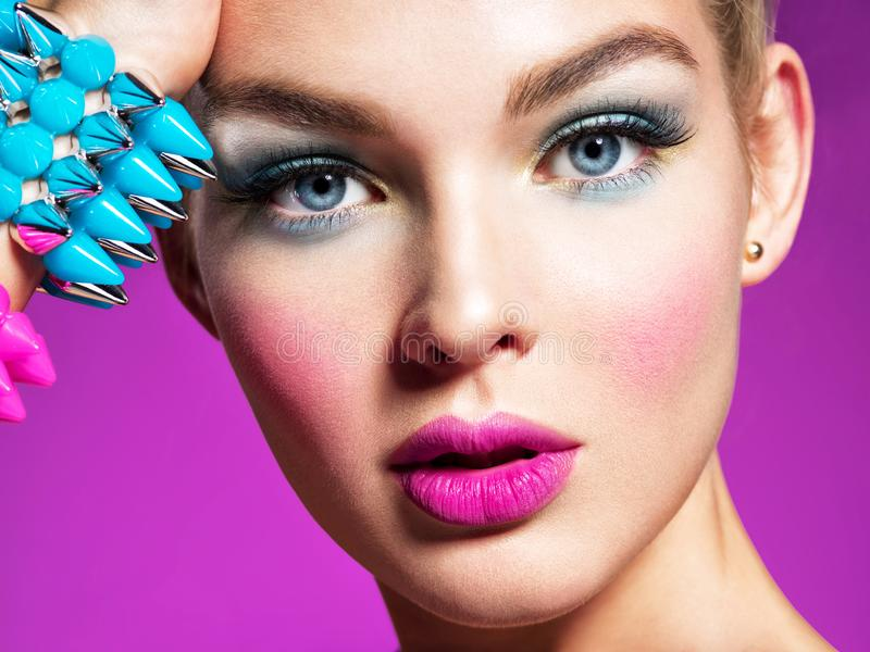 Fashion portrait of a beautiful woman with bright makeup. stock photography