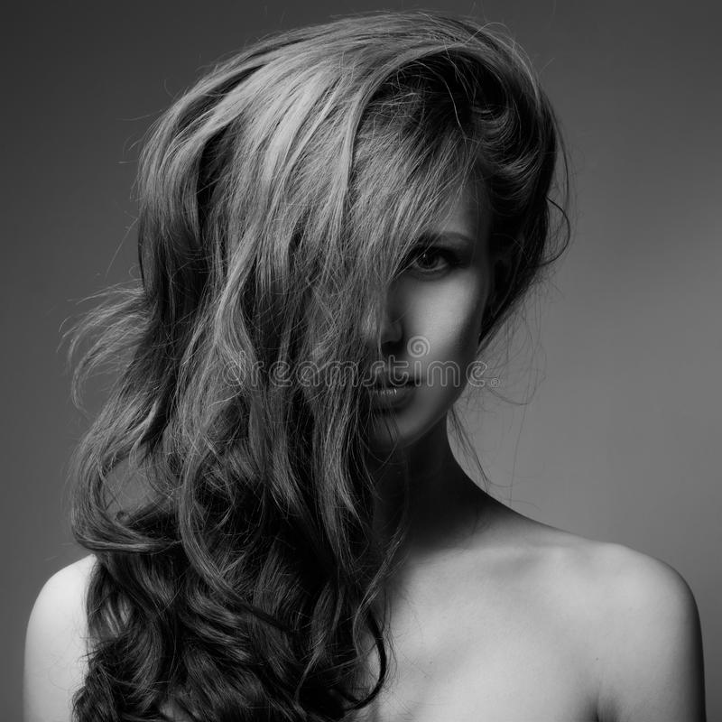 Fashion Portrait Of Beautiful Woman. Curly Long Hair. BW stock photo