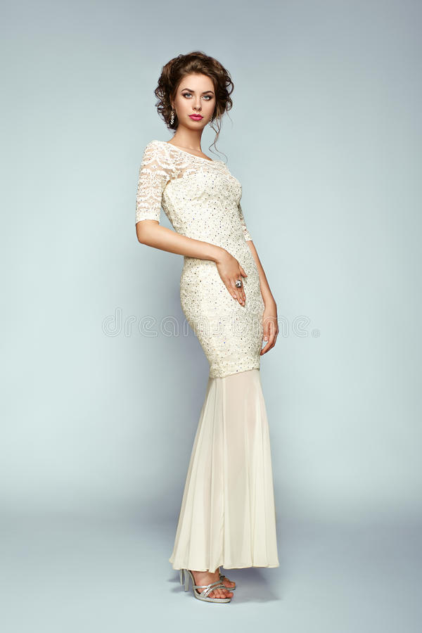 Fashion portrait of beautiful woman in elegant dress royalty free stock photos
