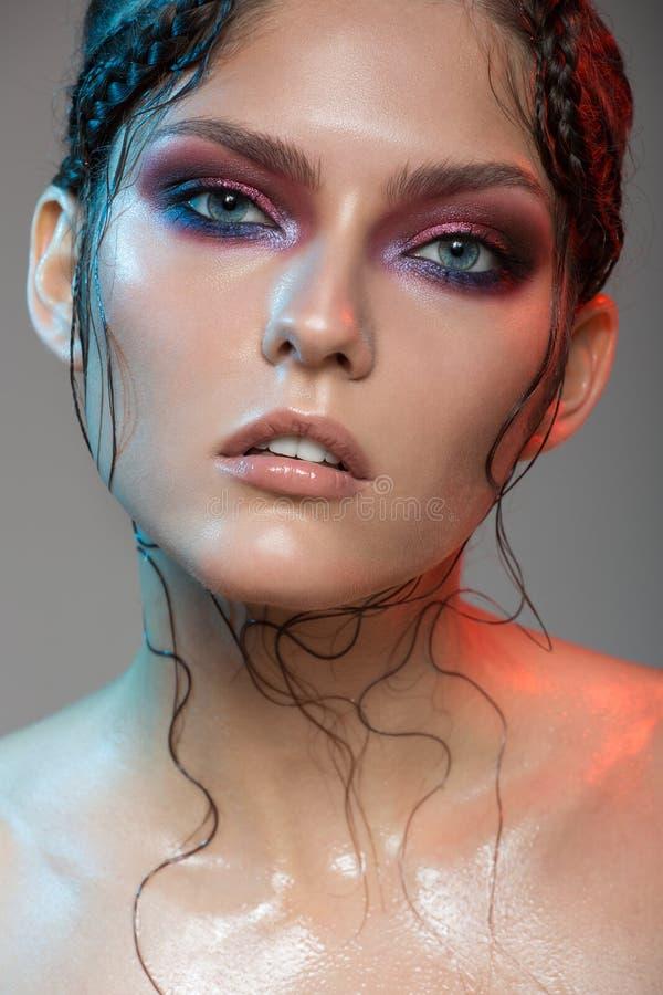 Fashion portrait of beautiful woman. Fantasy make-up stock photography