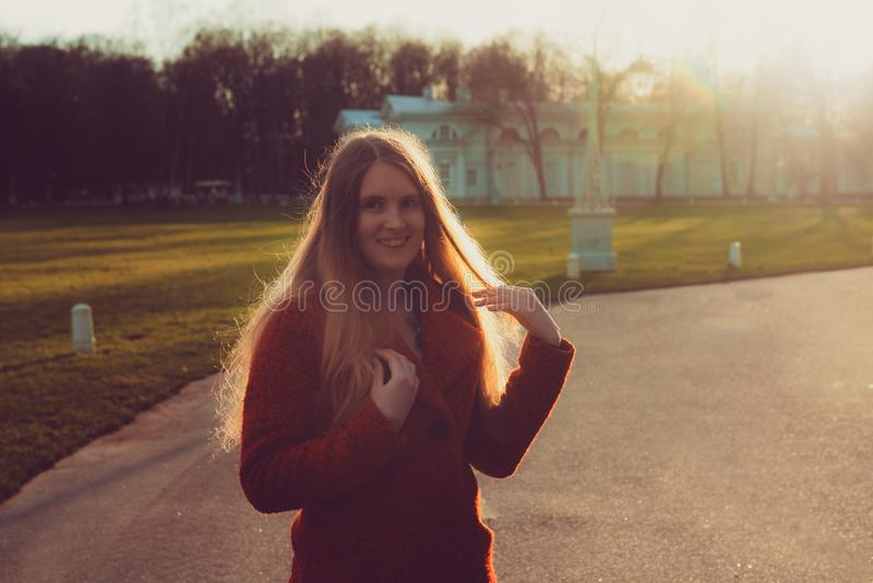 Woman in the spring park. beautiful girl portrait in sunset royalty free stock image
