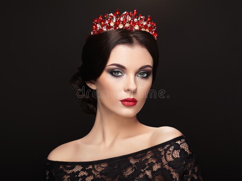 Fashion portrait of beautiful woman with tiara on head royalty free stock photos