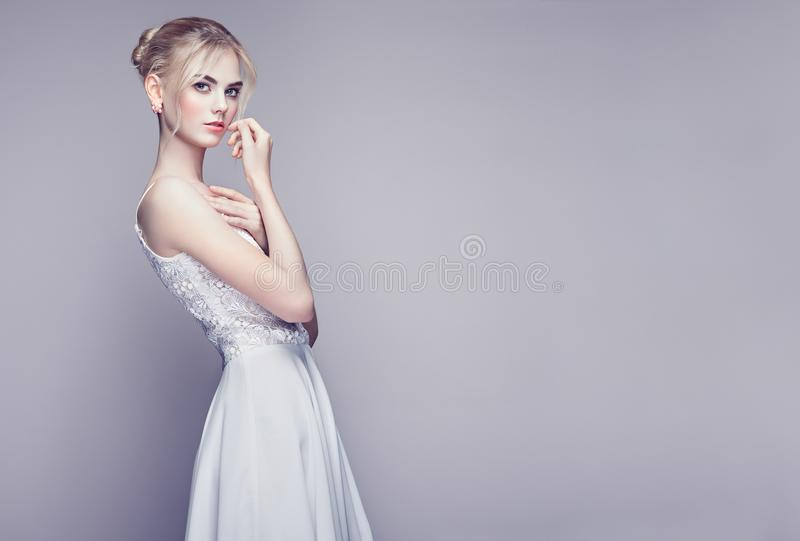Fashion portrait of beautiful young woman with blond hair royalty free stock image