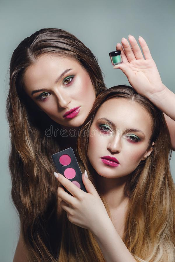 Portrait of beautiful young women with makeup stock images