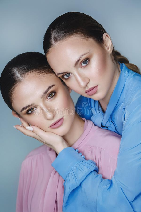 Portrait of beautiful young women with makeup royalty free stock photography
