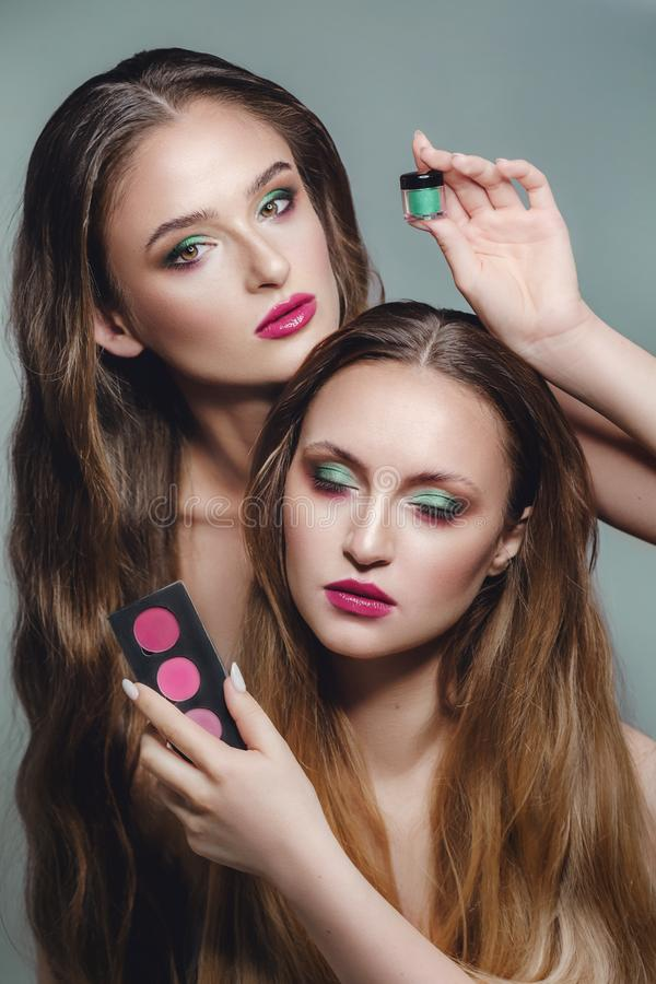 Portrait of beautiful young women with makeup stock image