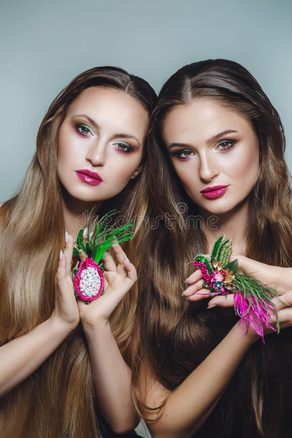 Portrait of beautiful young women with makeup stock photo
