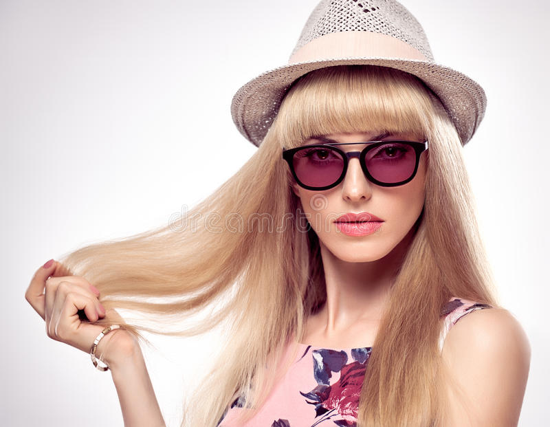 Fashion Portrait Blond Woman in Stylish glasses. Fashion Portrait Beauty Sensual Blond Woman in Stylish Sunglasses. Shiny Silky Straight hair, fashion Makeup stock images