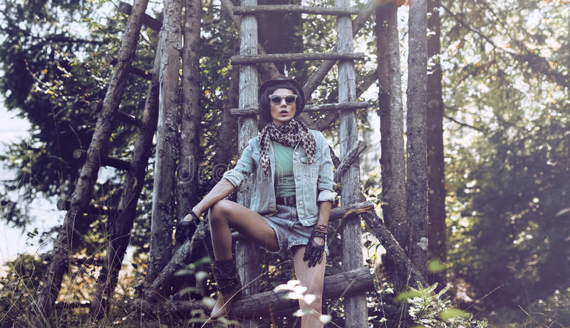 Fashion portrait brunette girl country style in the autumn fores. T royalty free stock photo