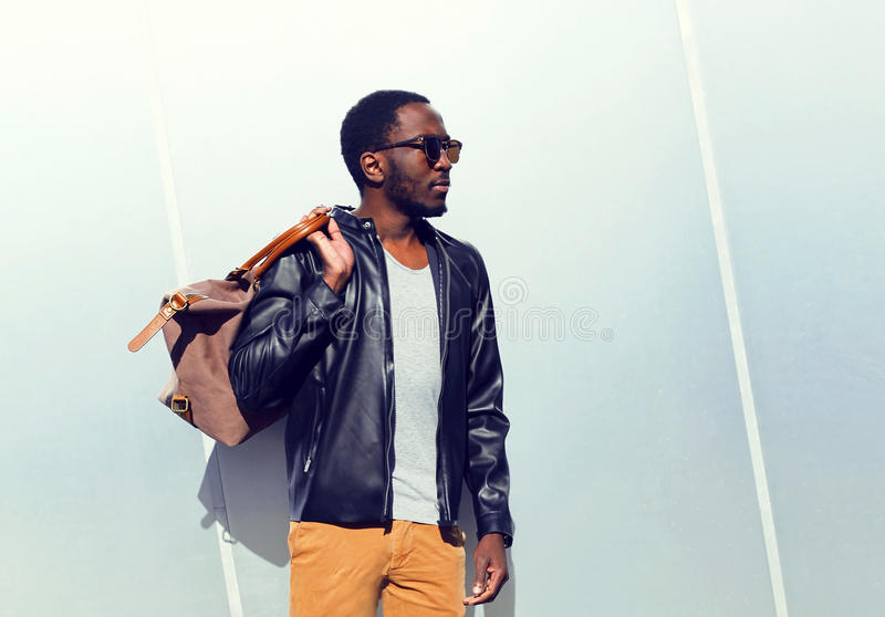 Fashion portrait confident african man with a bag in the city stock images