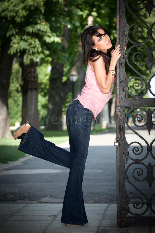 Fashion portrait of cute woman outdoor royalty free stock photo