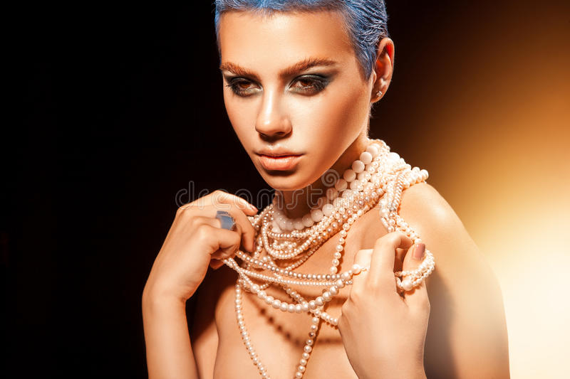 Fashion portrait of cutie young girl with nice makeup and pearls royalty free stock photos