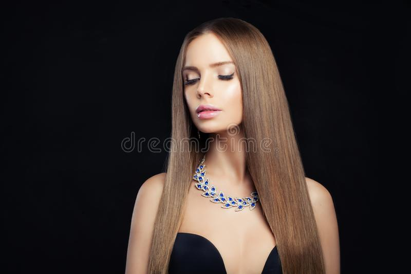 Fashion portrait of dark brown hair color women. Fashion portrait of dark brown hair color woman with diamond necklace stock images