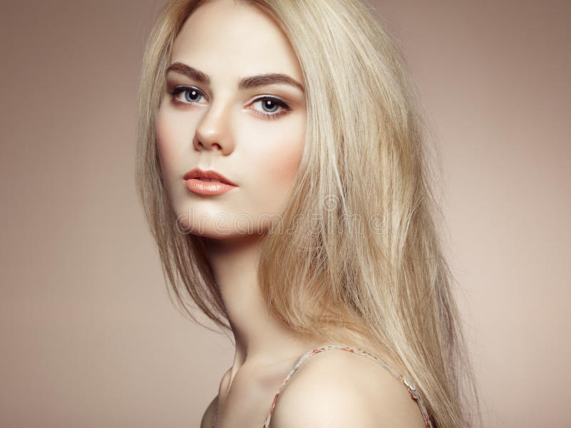 Fashion portrait of elegant woman with magnificent hair. Blonde girl. Perfect make-up. Hairstyle stock photos