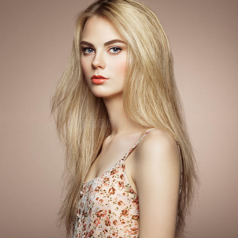 Fashion portrait of elegant woman with magnificent hair. Blonde girl. Perfect make-up. Hairstyle royalty free stock photo