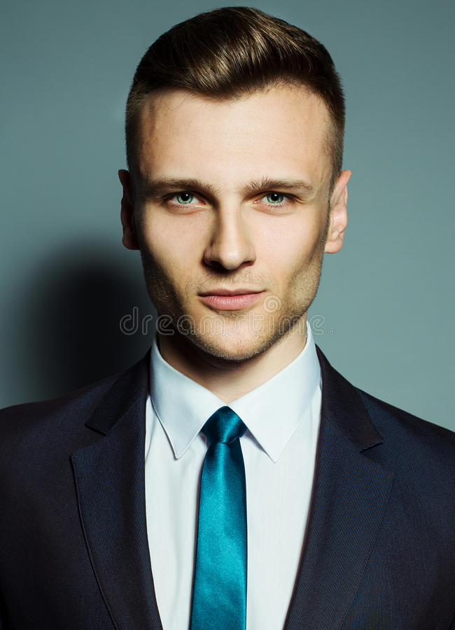 Fashion portrait of elegant young handsome man stock images
