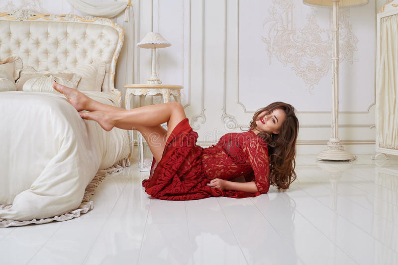 Fashion portrait of elegant young woman in a luxurious interior royalty free stock photo