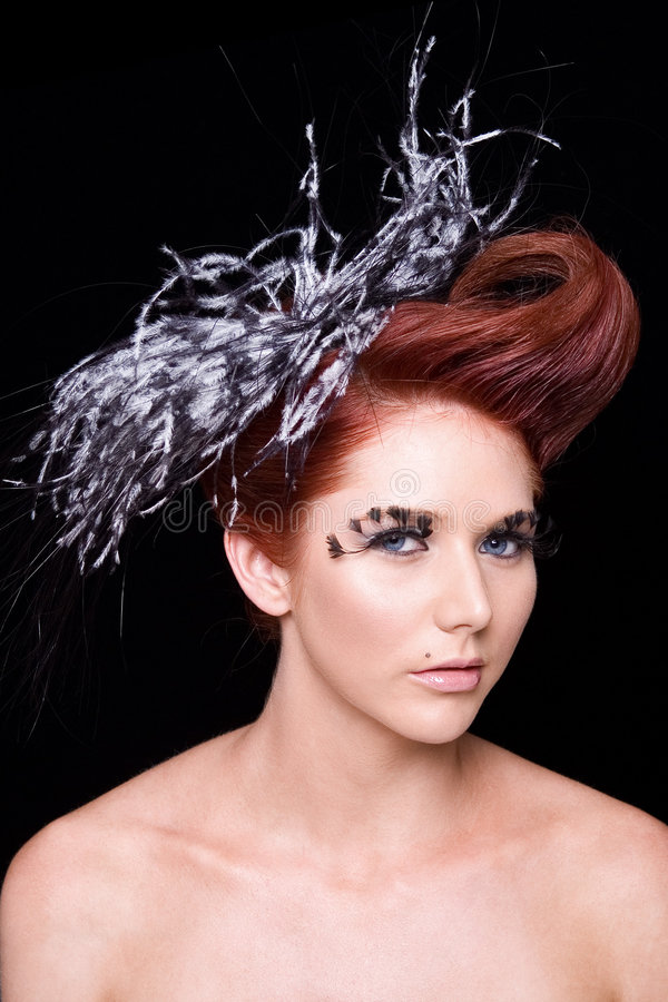 Fashion portrait with feathers stock image