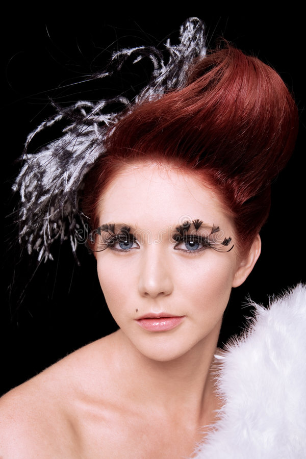 Fashion portrait with feathers royalty free stock photos