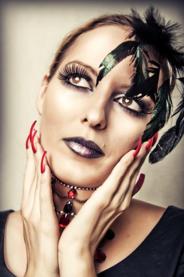 Fashion portrait of female vampire stock photo
