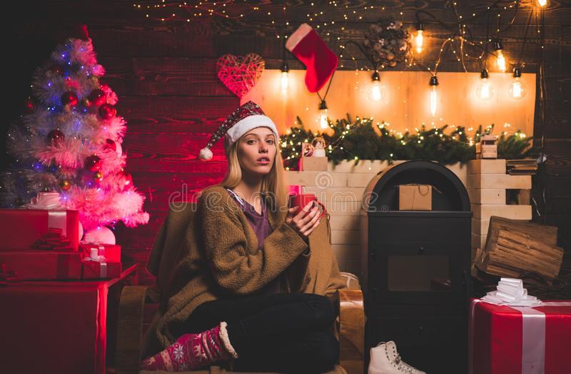 Fashion portrait of girl indoors with Christmas tree. Funny girl in Santa costume. Gift emotions. Emotions. Celebration royalty free stock photos