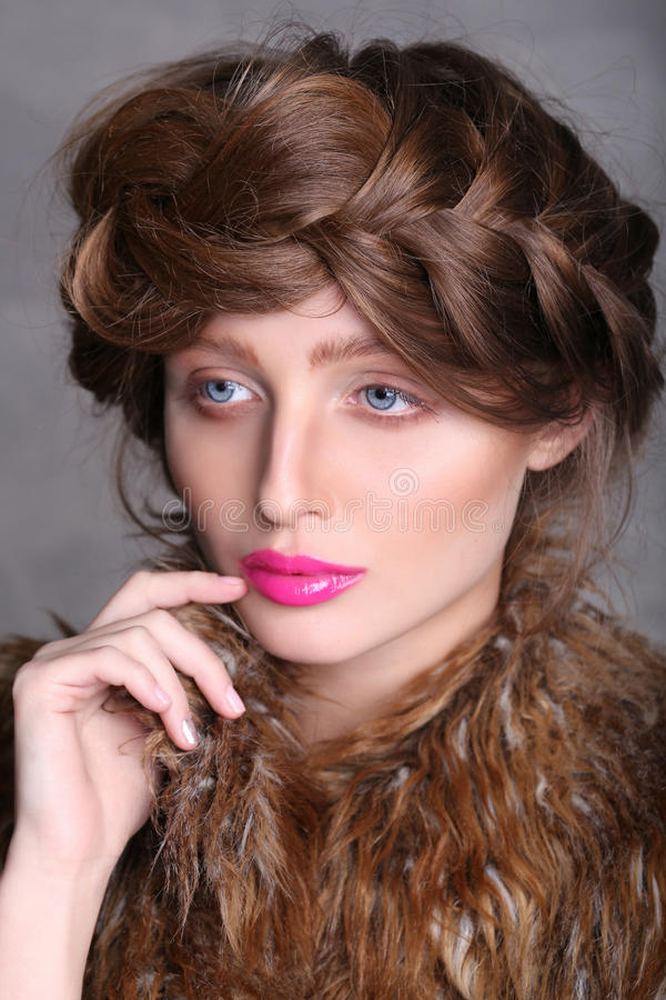 Fashion portrait girl's face with a pink lips and brown hair. stock images