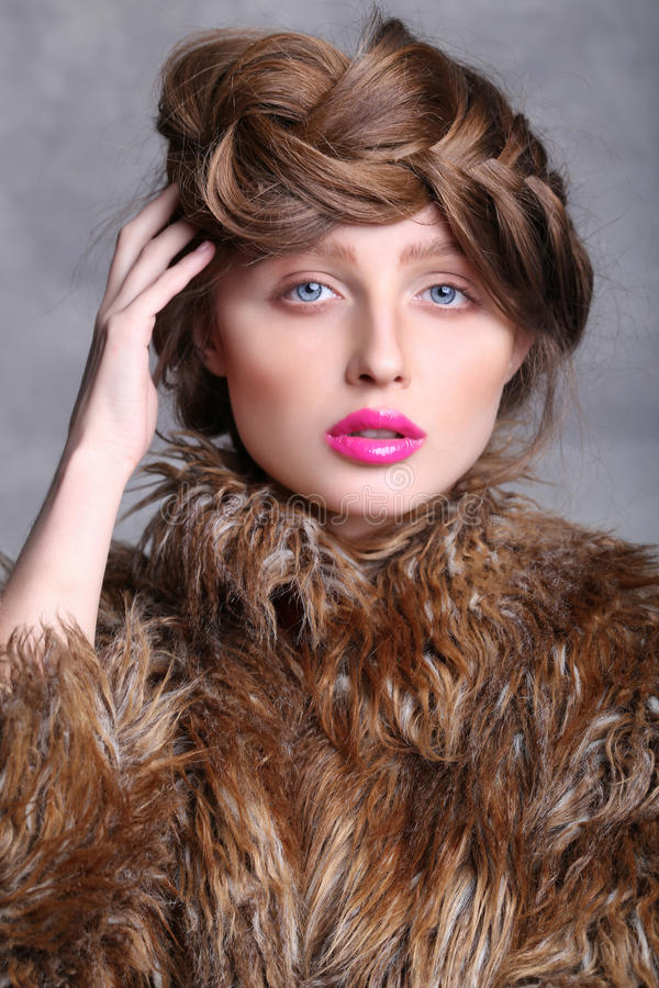 Fashion portrait girl's face with a pink lips and brown hair. royalty free stock photo