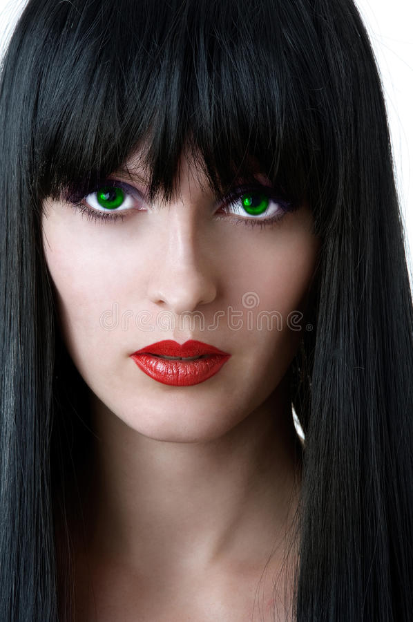 Fashion portrait of glamour woman. With green eyes black hair and seductive red lips closeup stock photography