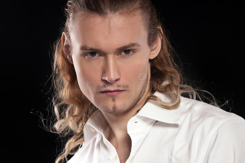 Fashion portrait of handsome young man royalty free stock photography