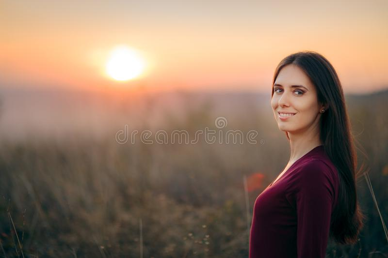 Fashion Portrait of a Happy Woman Admiring Sunset stock photos