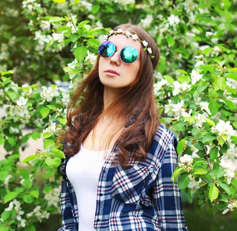 Fashion portrait hippie woman in a flowering garden stock photo