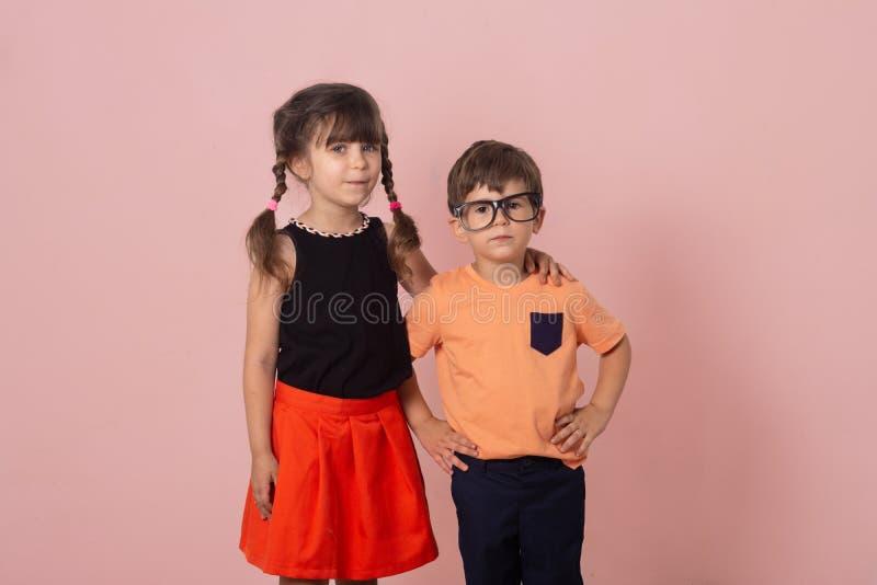 Fashion portrait kids standing on grey background. royalty free stock photo
