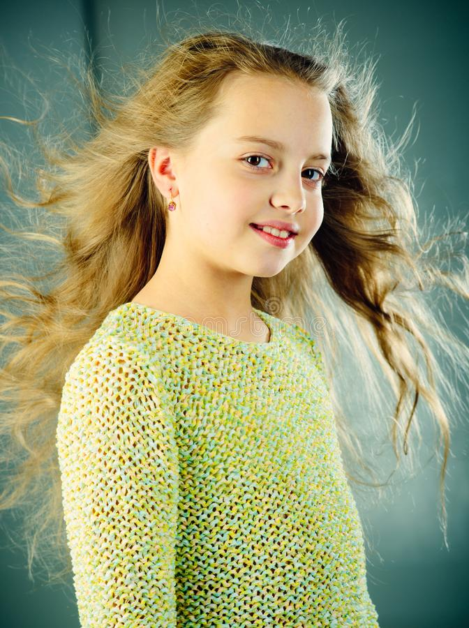 Fashion portrait of little girl. childhood of happy kid. beauty. kid hairdresser. Feeling free and happy. Skin and hair. Care. small girl with long hair stock photography