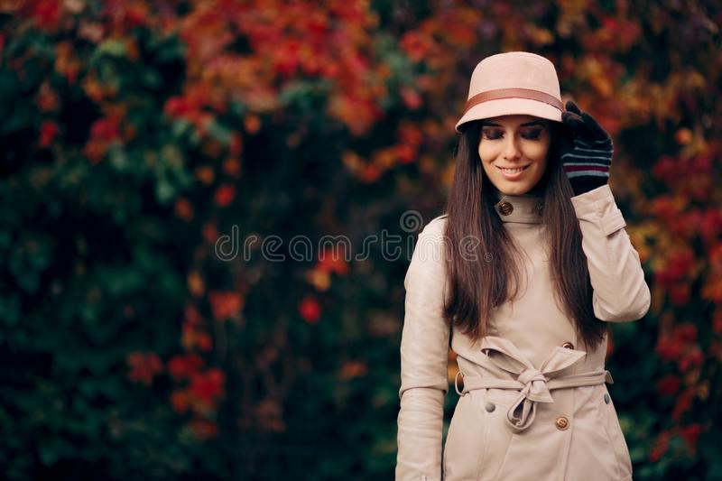 Woman Wearing Trench Coat and a Hat Fashion Portrait stock photos