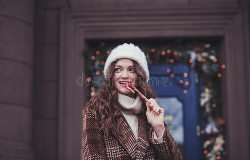 Sweet young woman with lollipop stock photography
