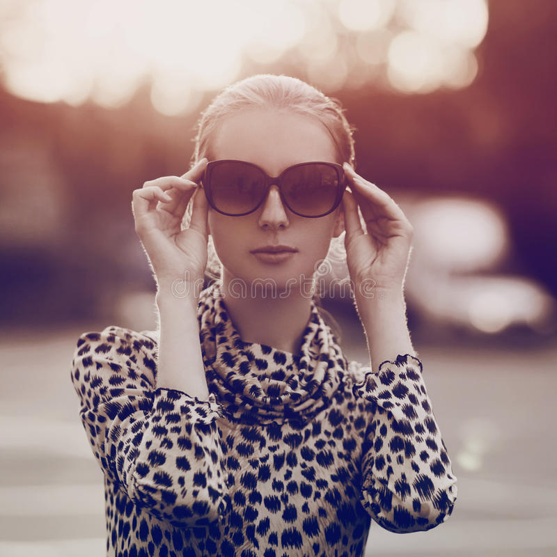 Fashion portrait pretty woman in sunglasses and dress stock images