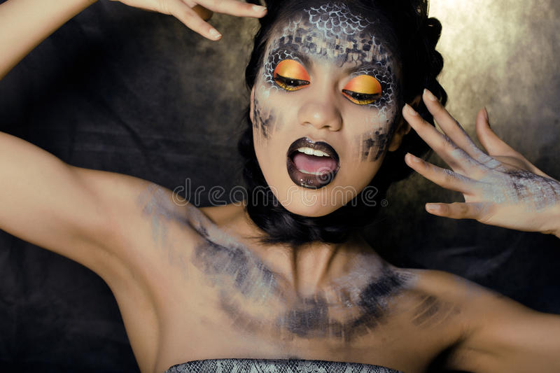 Download Fashion Portrait Of Pretty Young Woman With Creative Make Up Like A Snake Stock Photo - Image: 31635806
