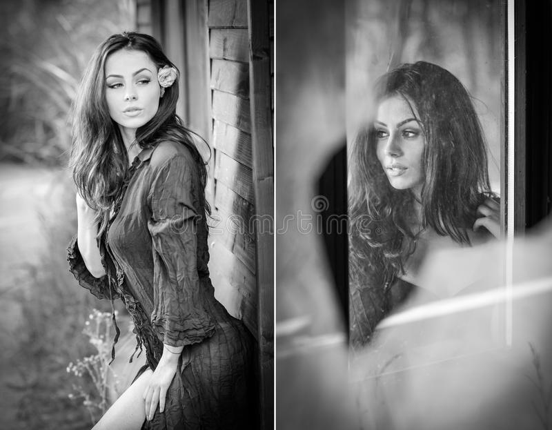 Fashion portrait of brunette in black blouse leaning on wooden cabin wall. Sensual attractive woman with a flower in hair stock images