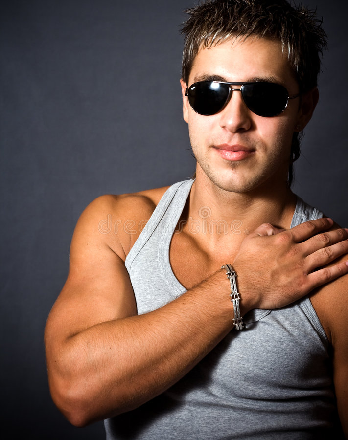 Fashion portrait of man with sunglasses stock photo