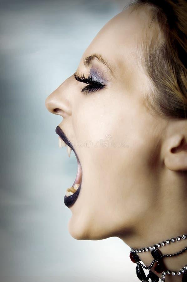 Fashion portrait of screaming vampire royalty free stock image