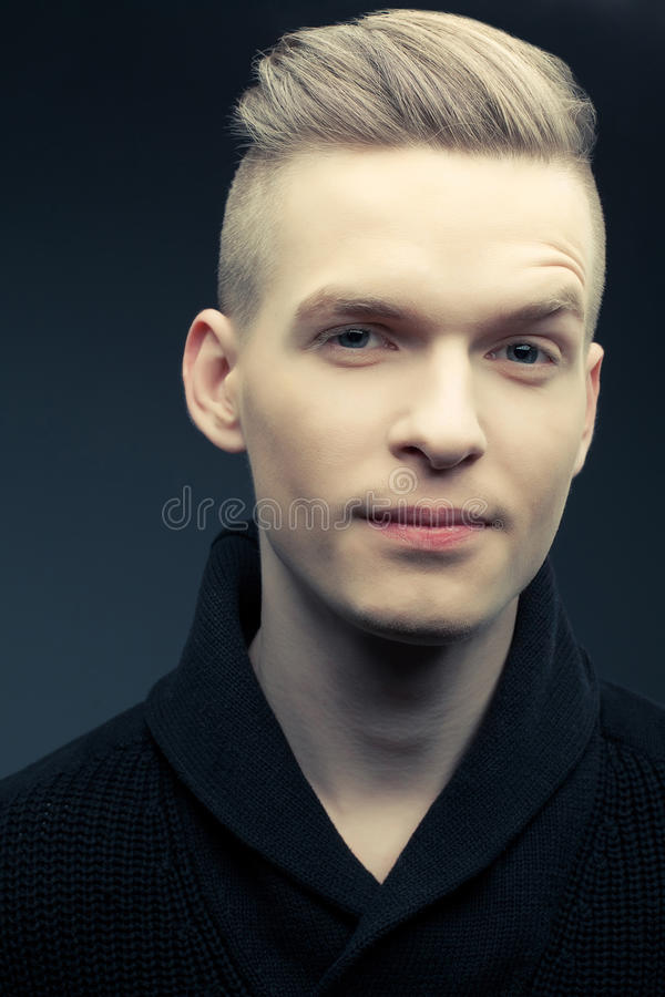 Fashion portrait of smiling elegant young and handsome man royalty free stock photography