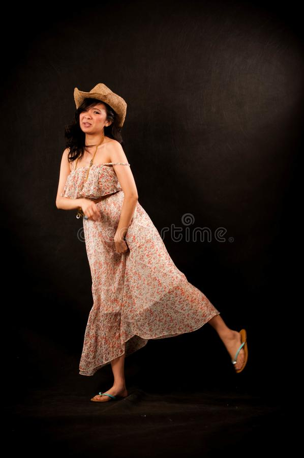 Fashion portrait in studio of beautiful young asian smiling woman feeling happy in success life stock photography