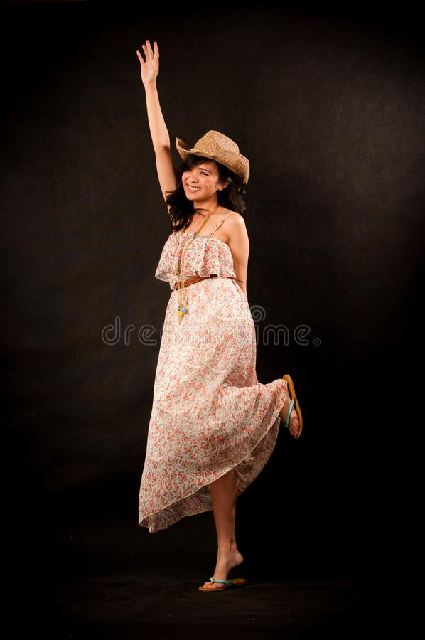 Fashion portrait in studio of beautiful young asian smiling woman feeling happy in success life stock photo