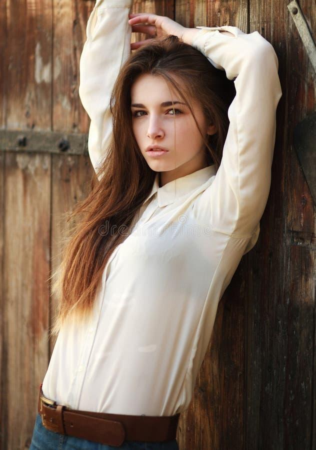 Fashion portrait stylish urban girl posing in old city street stock photo