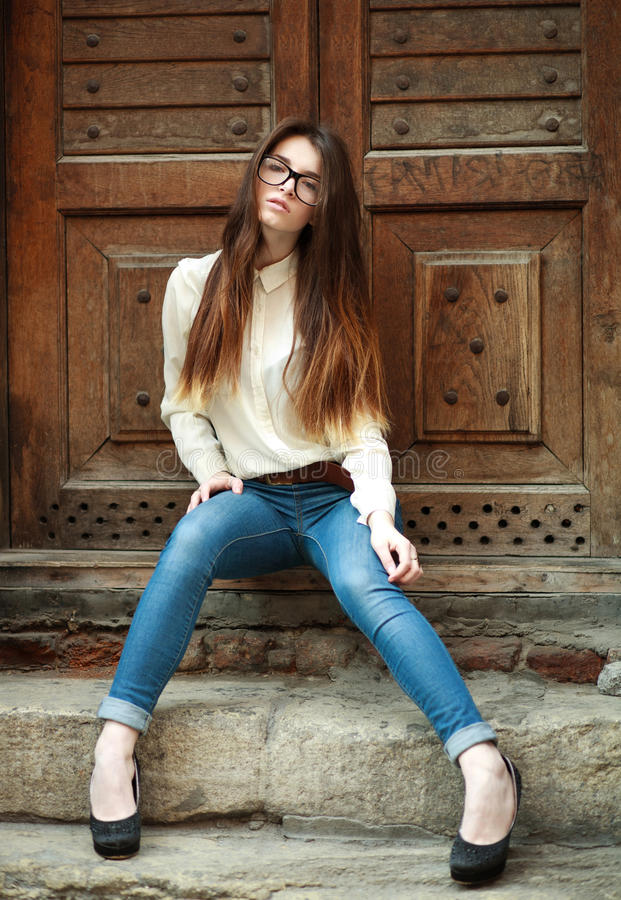 Fashion portrait stylish urban girl posing in old city street stock images