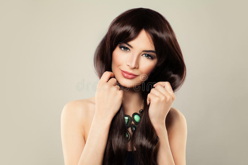 Fashion Portrait of Stylish Woman with Beautiful Hairstyle. And Makeup. Perfect Model with Long Healthy Hair stock image