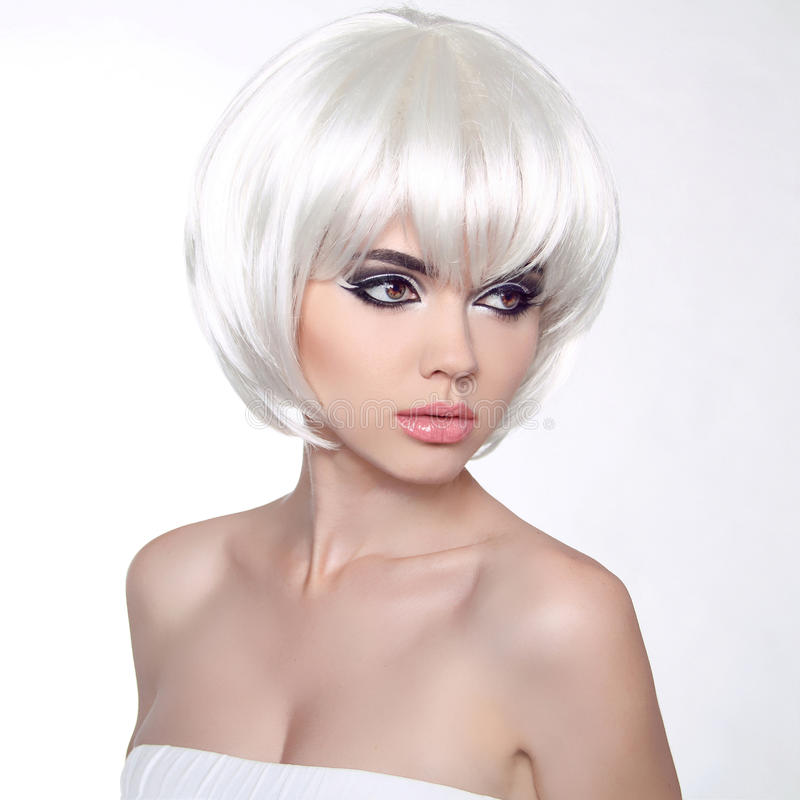 Fashion portrait with White Short Hair. Haircut. Hairstyle. Fringe. Professional Makeup. Make-up. Vogue Style Woman isolated on W. Hite Background royalty free stock images