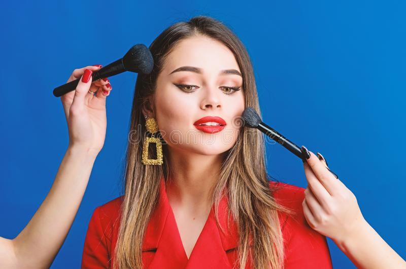 Fashion portrait of woman. beauty and fashion. hair beauty and hairdresser salon. jewelry earrings. Girl in red jacket. Sexy woman with professional makeup royalty free stock image