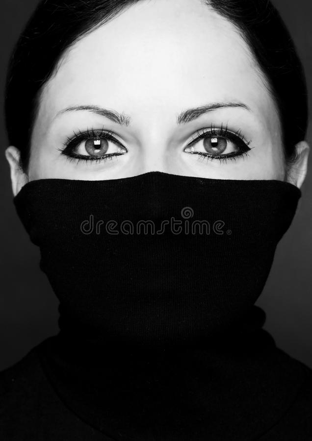 Fashion portrait of a woman with black polo neck. Look at woman eyes Black and white photo stock images