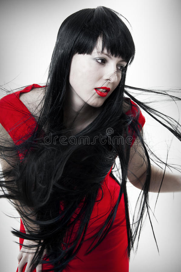 Fashion portrait of woman with flying hair stock image